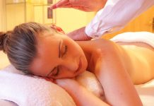 woman receiving a massage to increase serotonin