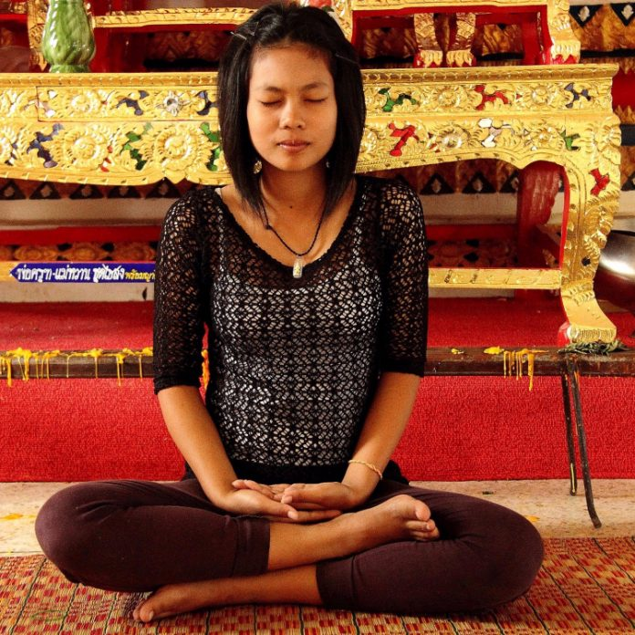 woman meditating to calm her overactive mind